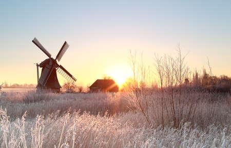 Dutch windmill at frosty winter sunrise Banco de Imagens