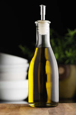 cooking oil: Bottle of olive oil in a kitchen. Stock Photo