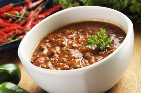 chili sauce: bowl of red hot chili with ground beef, beans and legumes. Stock Photo