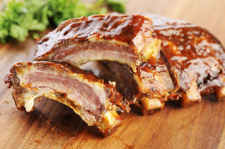 barbecue pork barbecue: Grilled sliced barbecue pork ribs on a wooden cutting board  Stock Photo