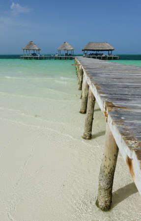 Pier and beach huts were caribbean Stock Photo