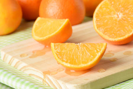 clementine fruit: Juicy tangerine clementine gold, was sliced ??cutting board