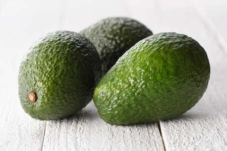 Fresh avocados on a white background