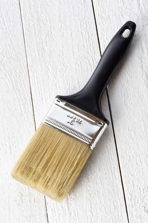 3 inch black and silver paintbrush on a white background Imagens