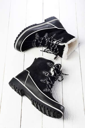 suede: Black and white winter boots made of suede and fur