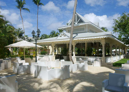 Tropical resort with white outdoor furniture on a sunny day