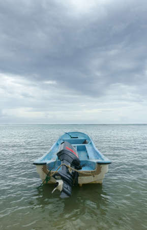 Motor boat on calm sea with dramatic sky