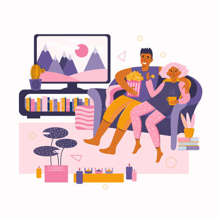 Man and a woman spend time together at home. Young couple watches movie on TV. Home online movie theater. Happy family leisure time in a romantic setting. Stay at home together. Spending time at home.