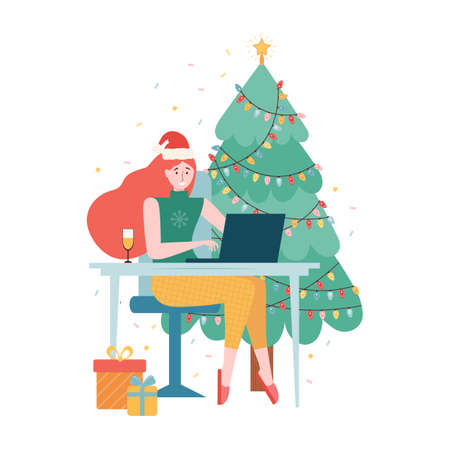 Christmas Online internet party. New year celebration in quarantine mode. Girl in a Santa hat and a glass of champagne is sitting with a laptop near the Christmas tree. Holiday event remotely at home