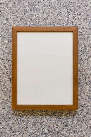 mantelpiece: Frame Wooden on marble walls Stock Photo