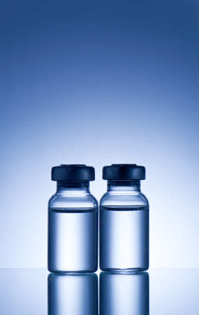 maladies: medical ampoules on blue background
