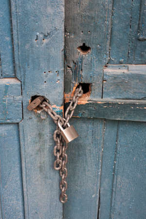 Old blue wooden door Locked with a chain and padlock photo