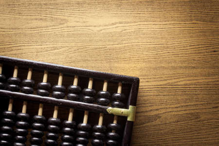 cost estimate: Abacus on a wooden floor