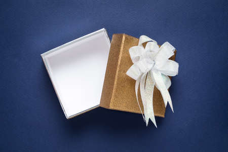 blue box: Luxury golden gift box on blue background