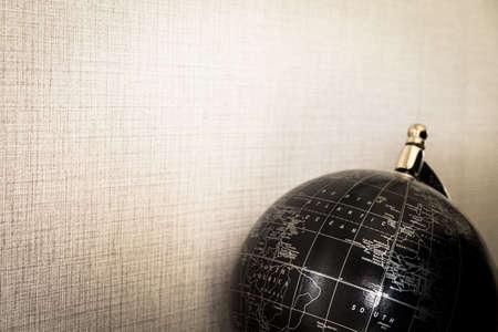 Globe black on brown background