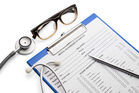 Patient information with pen glasses and stethoscope white background