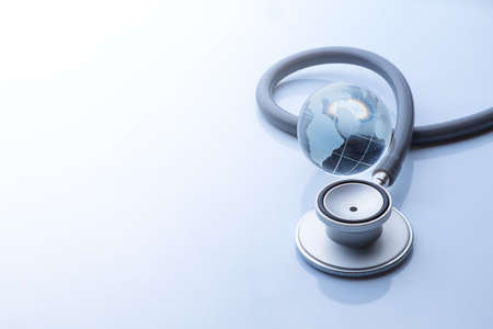 pandemic: Global healthcare. Globe and stethoscope blue tone on white background