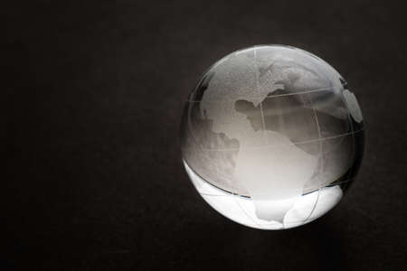 Glass globe on a black background