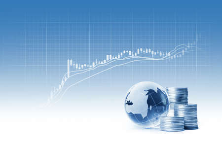 silver coins: globe and silver coins and Stock Charts on blue background Stock Photo