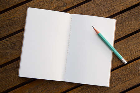 Notebook pencil on a wooden table