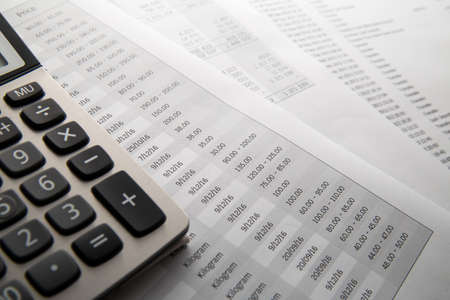 Calculator On the financial account documents. Financial concept