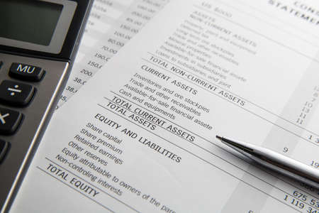 Pen, calculator On the financial account documents. Financial concept
