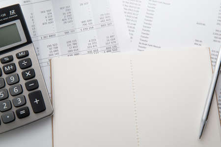 Pen, calculator and notebook on the financial account documents. Financial concept 免版税图像