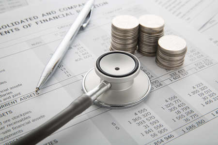 Pen, Stethoscope, Money on the document. Financial concept