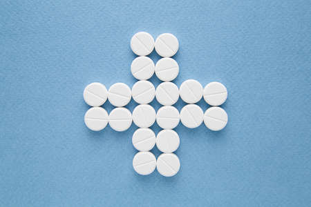 White pills on blue background 免版税图像