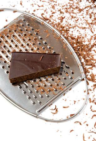 ちょうどチョコレート チップを作るためのおろし金のクローズ アップ 写真素材