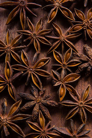 The pattern of badyan seeds on the wood Stock Photo