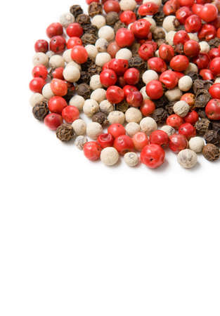 The mixed pepper seeds on white background