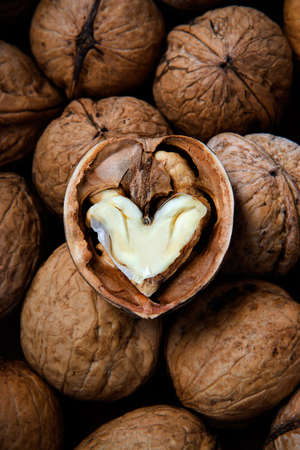 The cracked walnut with heart-shaped core Stock Photo - 747607