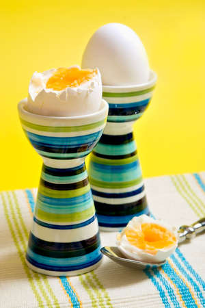Boiled eggs in tall striped egg-cup