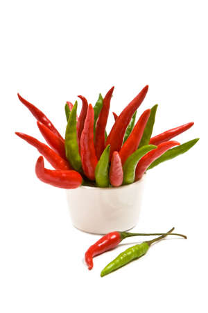 Red and green chilli peppers on white background Stock Photo