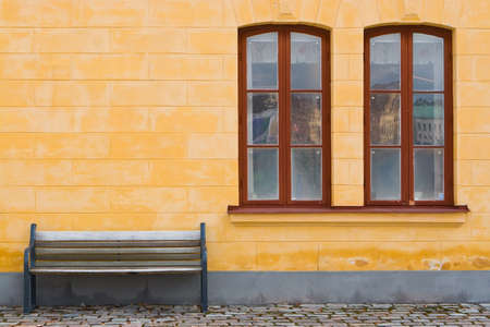Bench and yellow wall Stock Photo