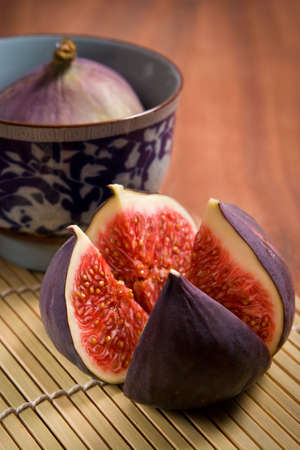 Fresh figs on the bamboo mat background