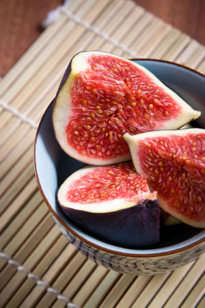 purple fig: Fresh figs on the bamboo mat background