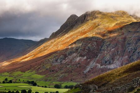 langdale pikes: View of the Langdale Pikes in the English Lake District during autumn under a moody sky and beautiful light.