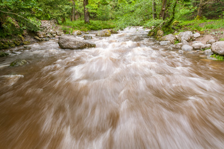 Fast flowing river Aira Beck near Ullswater in the English Lake District, Cumbria, Great Britain.