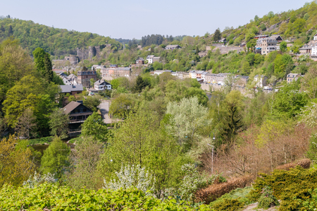 The historic town La Roche-en-Ardenne with the castle in the background seen from a hillside during early spring.