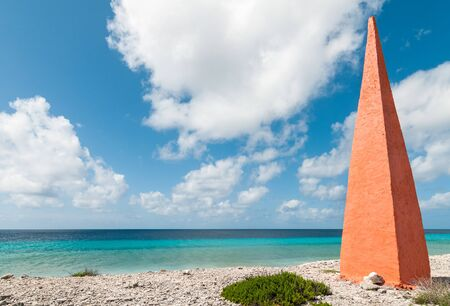Orange obelisk at beach of the caribbean island Bonaire