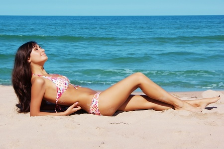 beautiful tanned girl on the beach
