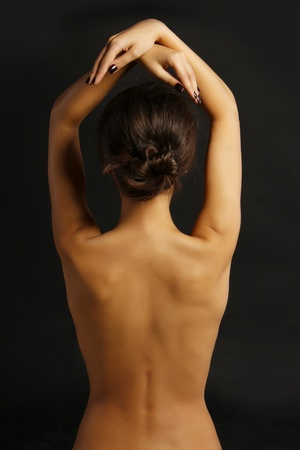 naked back of a young woman photo