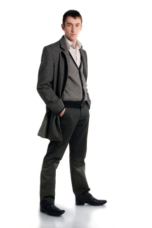 young guy wearing overcoat studio shot photo