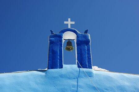 church bell against blue sky (Santorini Island, Greece) photo