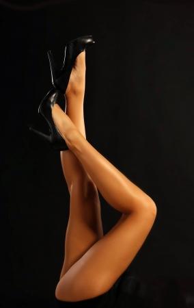 beautiful legs against black background