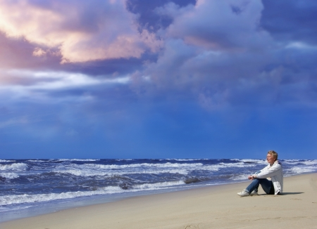 adult woman watching the stormy sea photo