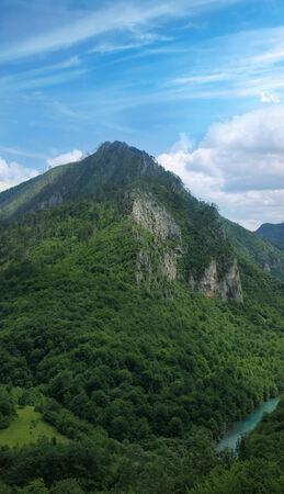 hill of tara: Tara river canyon in Montenegro - green mountain slopes and blue sky Stock Photo