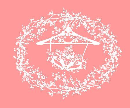 Elegant ornate carnival mask on hanger among blooming sakura tree branches